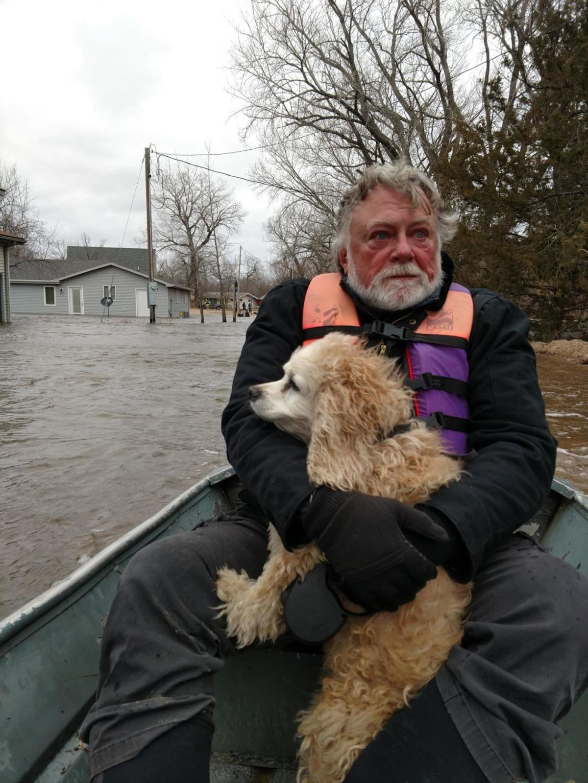 man and dog - Nebraska News Service top headlines