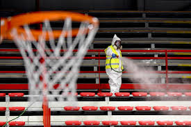 Operators of Naples Services in Italy sanitize the sports facility of Palabarbuto to counteract the danger of contagion from coronavirus.(Ciro Fusco / European Pressphoto Agency)