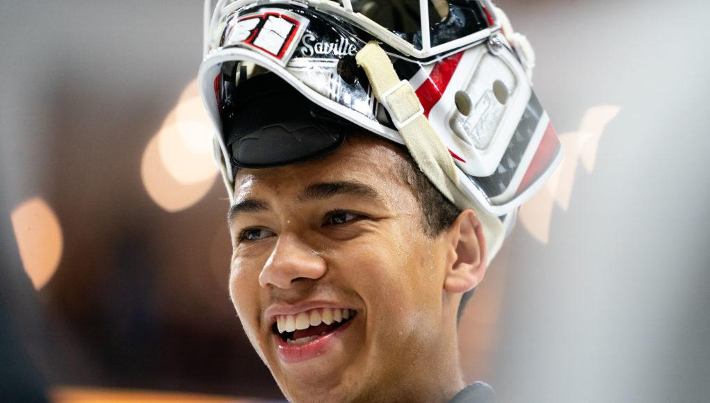 UNO hockey goalie Isaiah Saville smiling