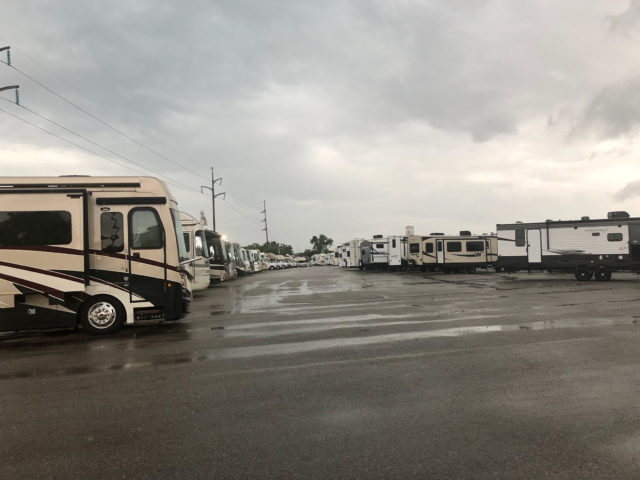 Image shows the parking lot at Leach's Camper Sales of Lincoln on an overcast day.