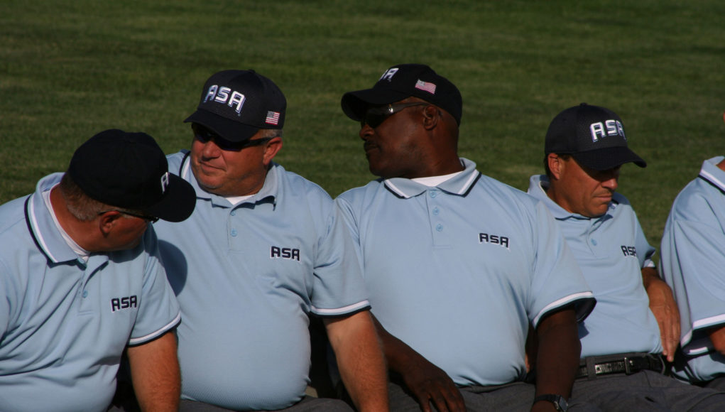 Umpires waiting to be introduced at the Opening Ceremony at Under Western Nation Tournament in Gillett, Wyoming in 2014