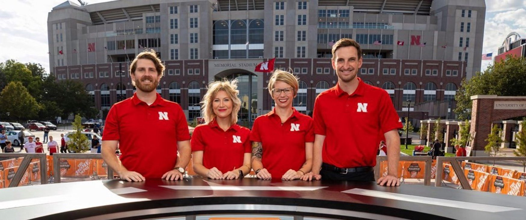athletic department staff stands in front of Memorial Stadium on the set of College Gameday