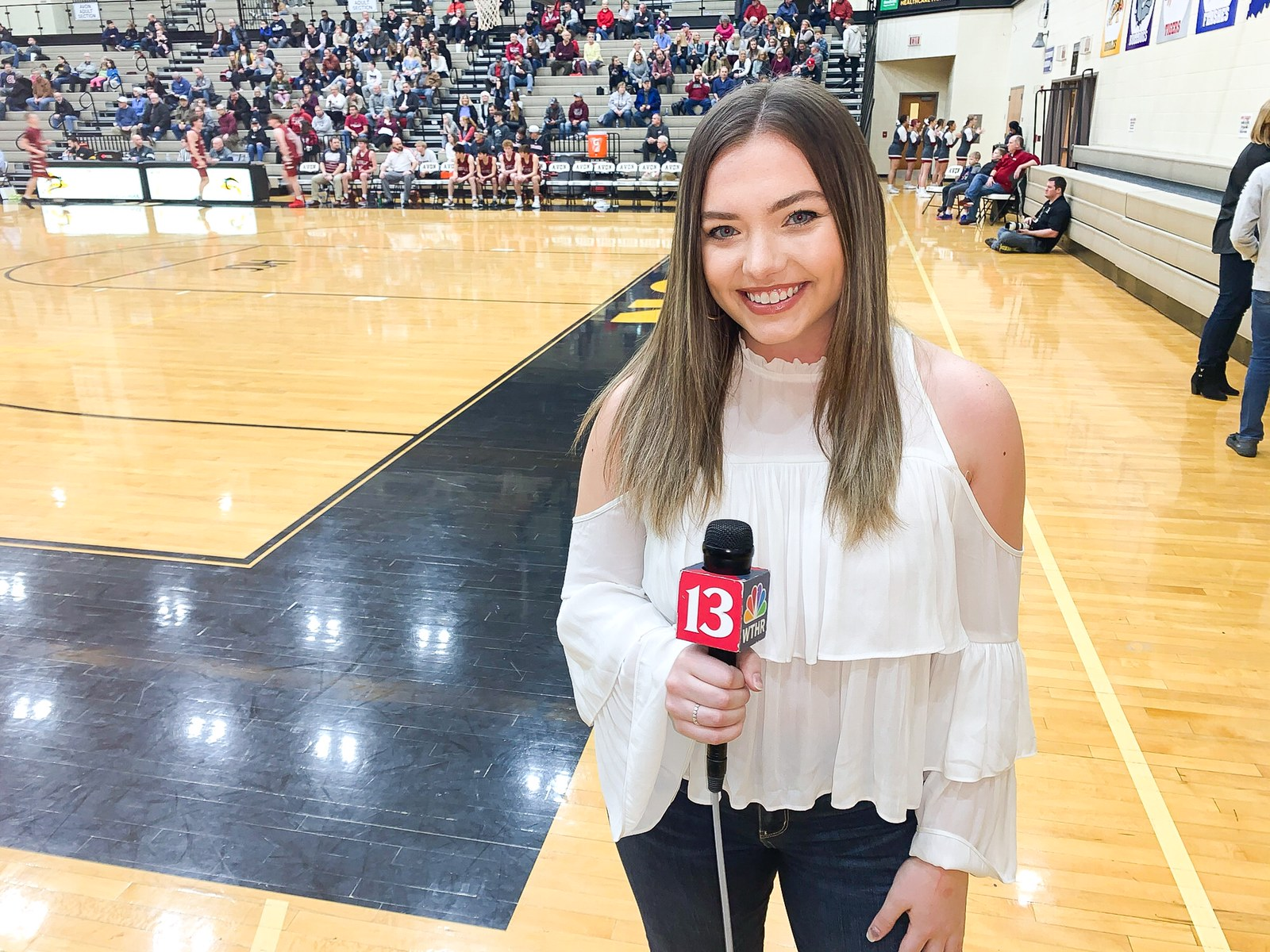 Kasper reporting at a basketball game