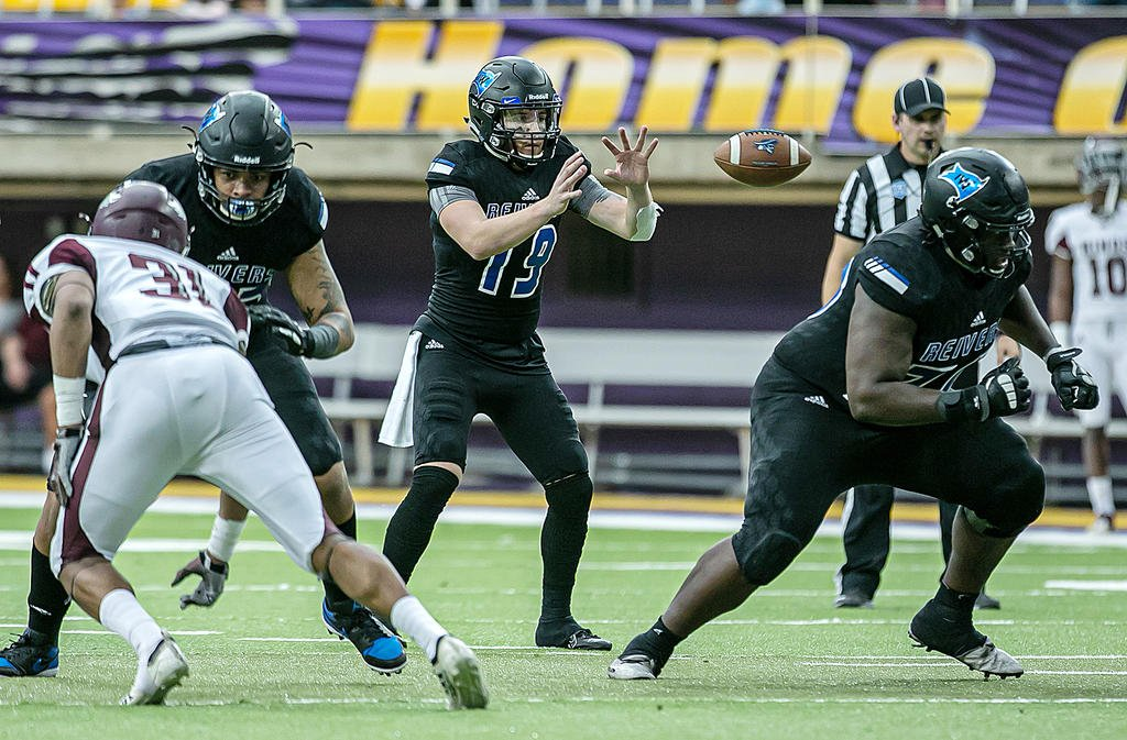 Iowa Western football action from the 2019 season, quarterback taking a snap