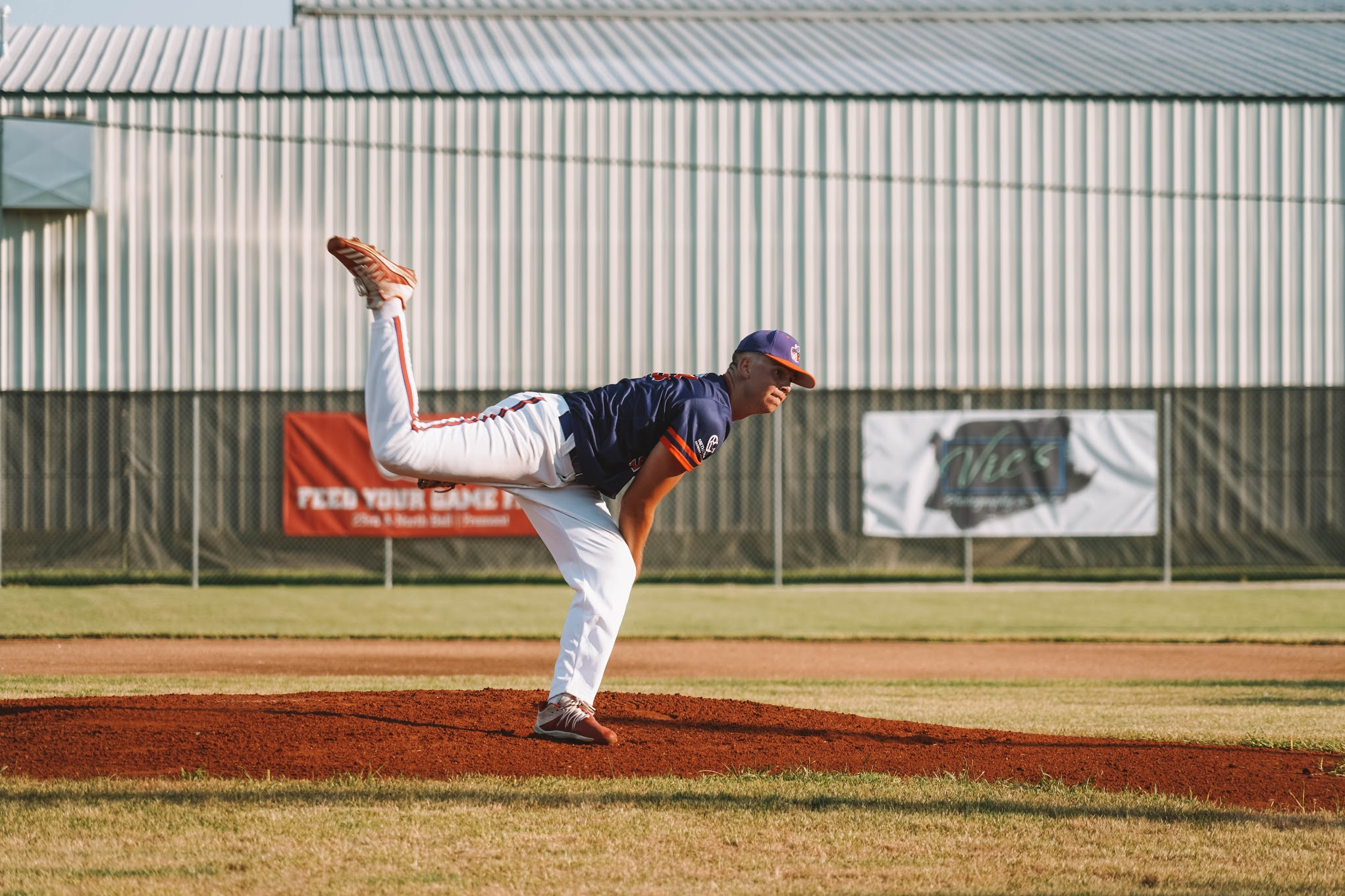 Huskers right-handed pitcher Quinn Mason throwing a pitch for the Fremont Moo
