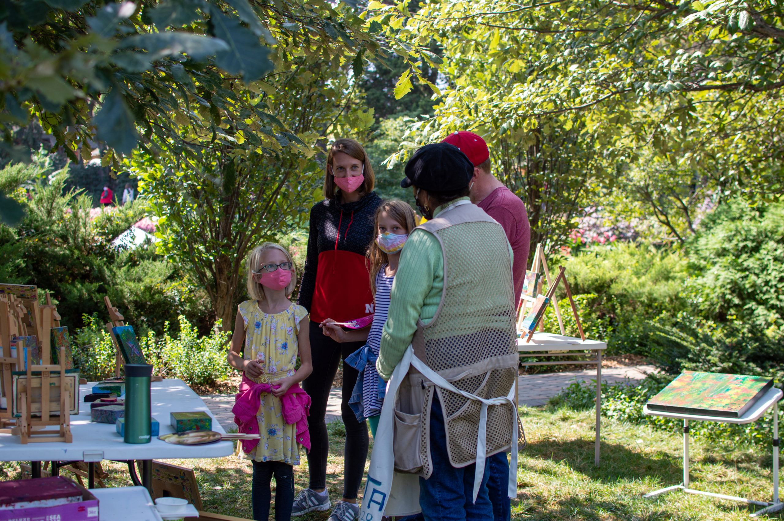 Artists discuss their artwork with event-goers at Art in the Garden held at Sunken Gardens on Saturday, Sept. 12, in Lincoln.