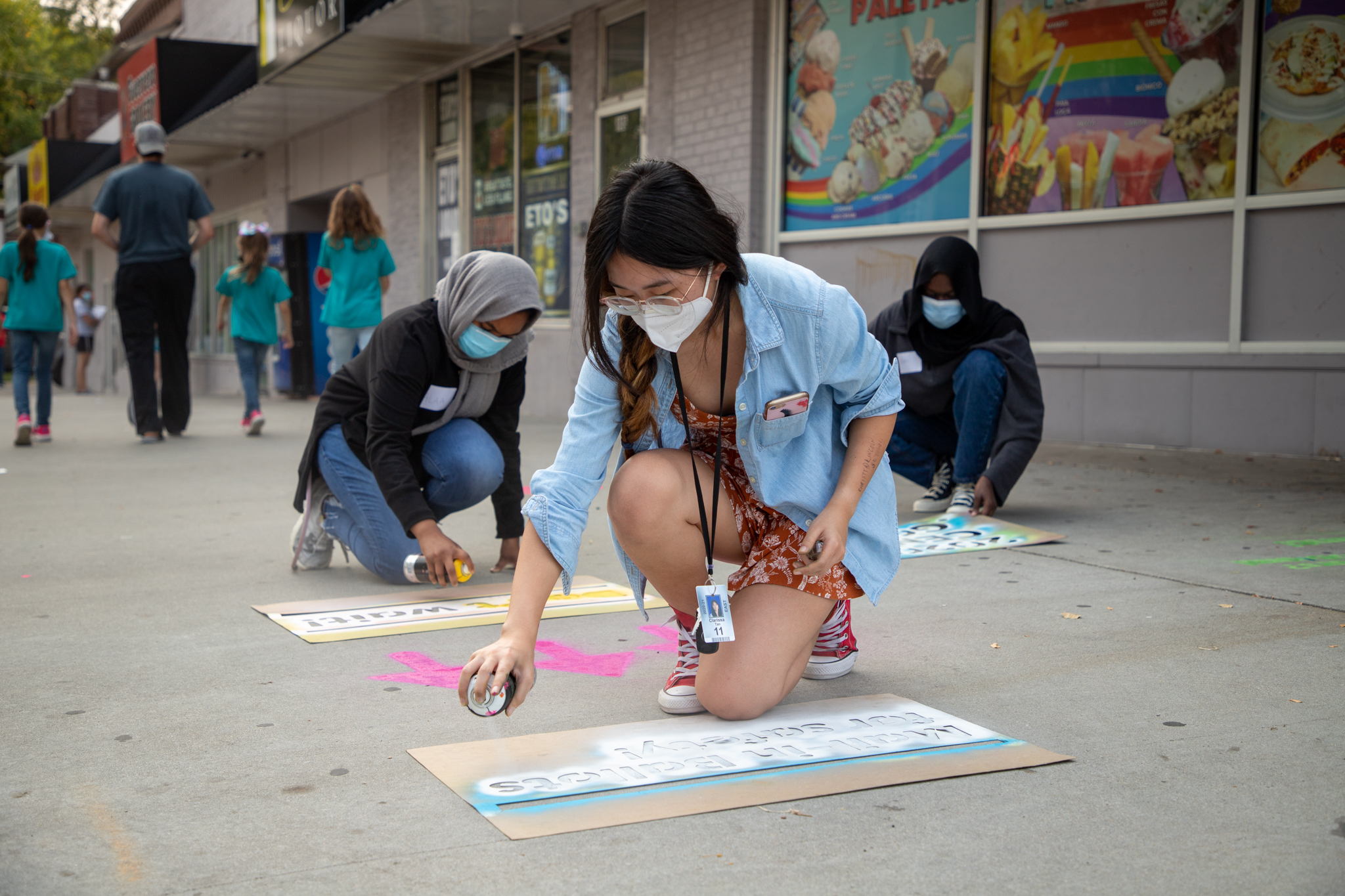 Volunteer, Clarissa Tan spray chalks a message on the ground off of 11th and G Street to encourage voter participation in the upcoming general election on Friday, Sept. 25 in Lincoln.