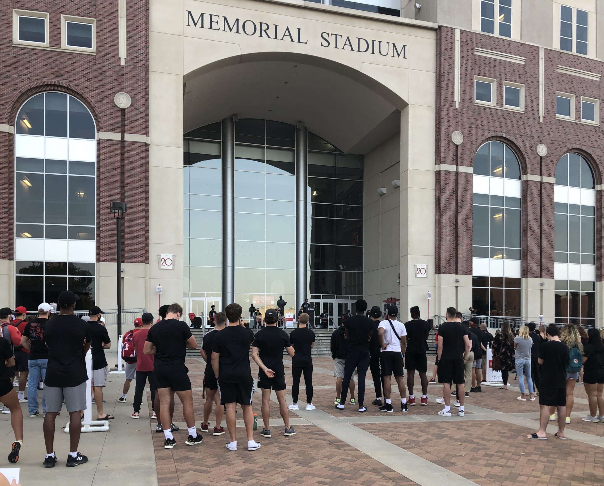 Crowd gathers at Minority Student-Athlete Collective rally in front of memorial stadium