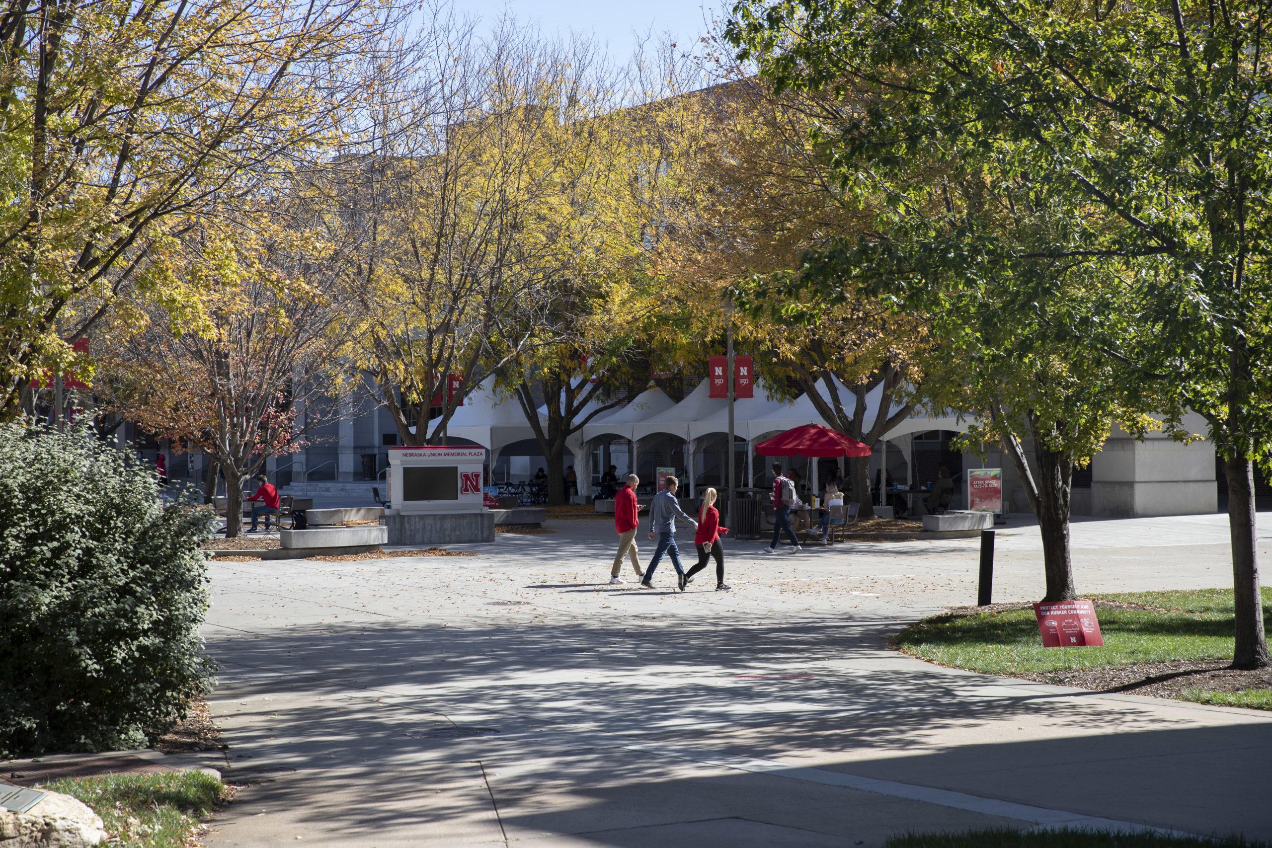 Students and faculty walk across the University of Nebraska-Lincoln campus near the Nebraska Union on Tuesday, October 13, 2020 in Lincoln, Nebraska.