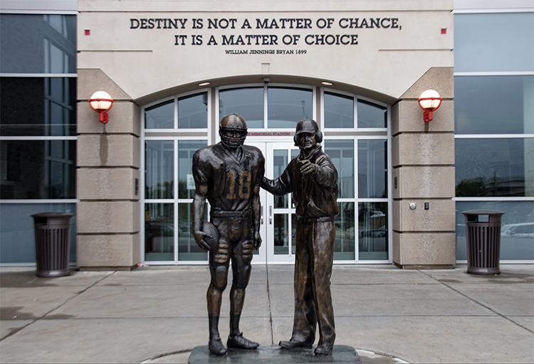 Former Huskers Football Head Coach Tom Osborne and standout quarterback Brook Berringer are featured in this statue at Memorial Stadium's north entrance on Sunday, Sept. 29, 2019. Berringer was killed in a plane crash two days prior to the NFL Draft in 1996. Photo by Megan Crain.