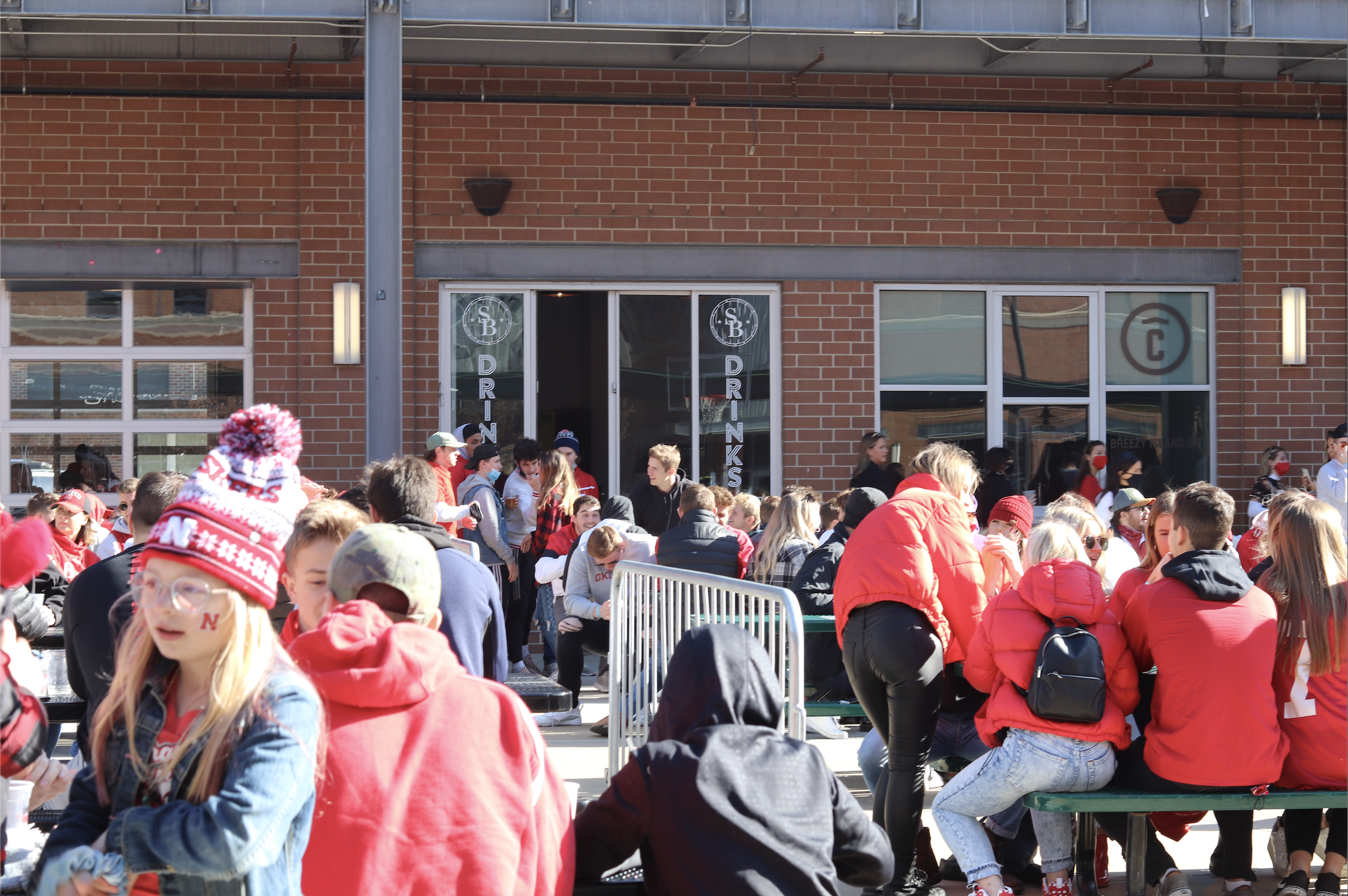 Huskers fans at The Railyard watch Saturday's game between Nebraska and Northwestern on Saturday, Nov. 7. Photo by James Rowland