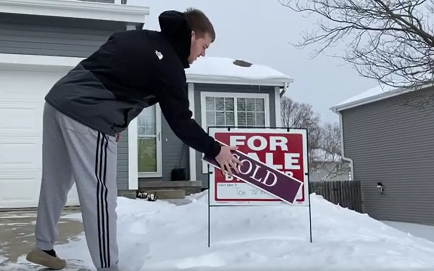 Man places sold sign in his yard