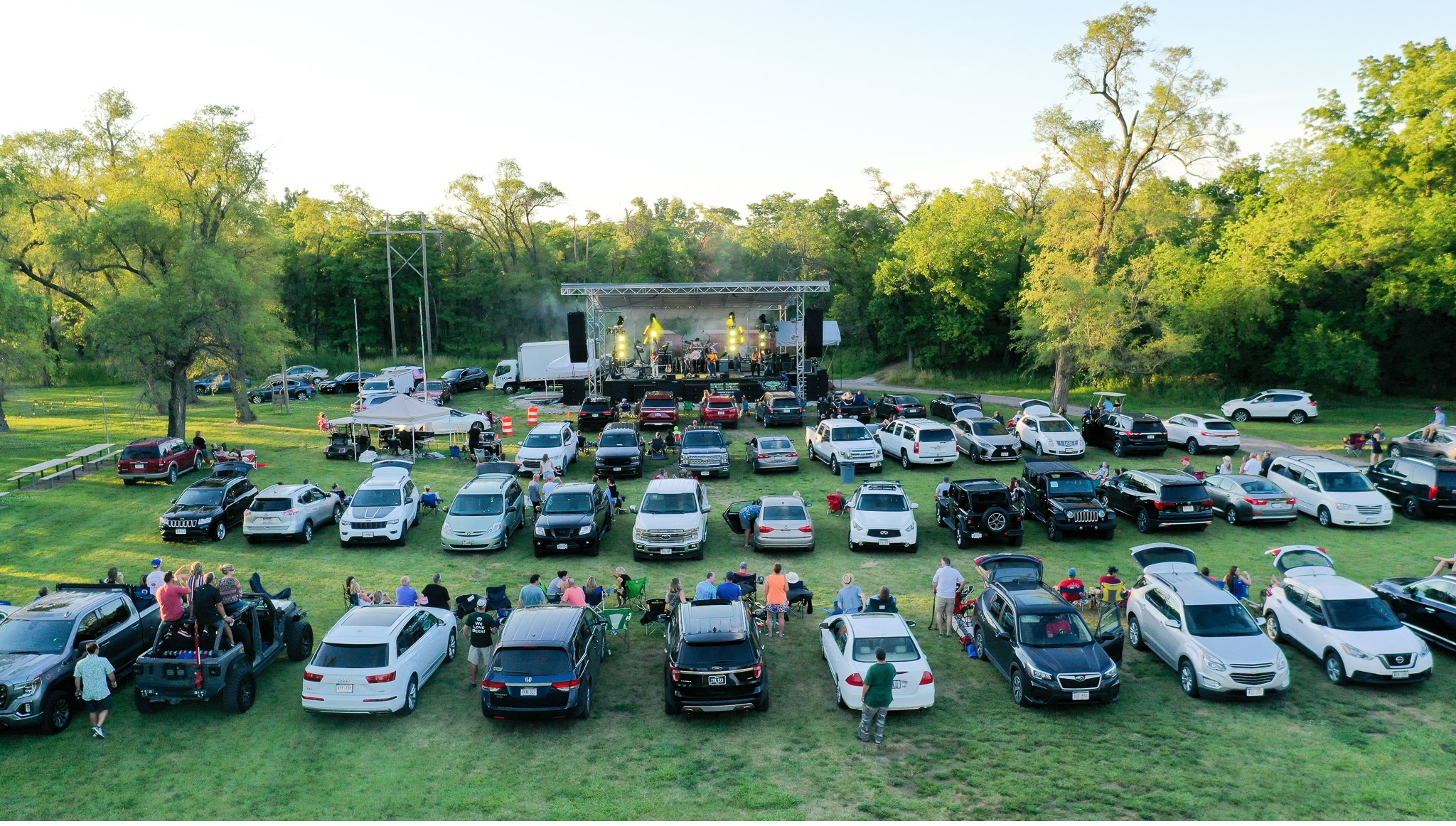 Cars sit in rows at Falconwood Park for drive-in concert