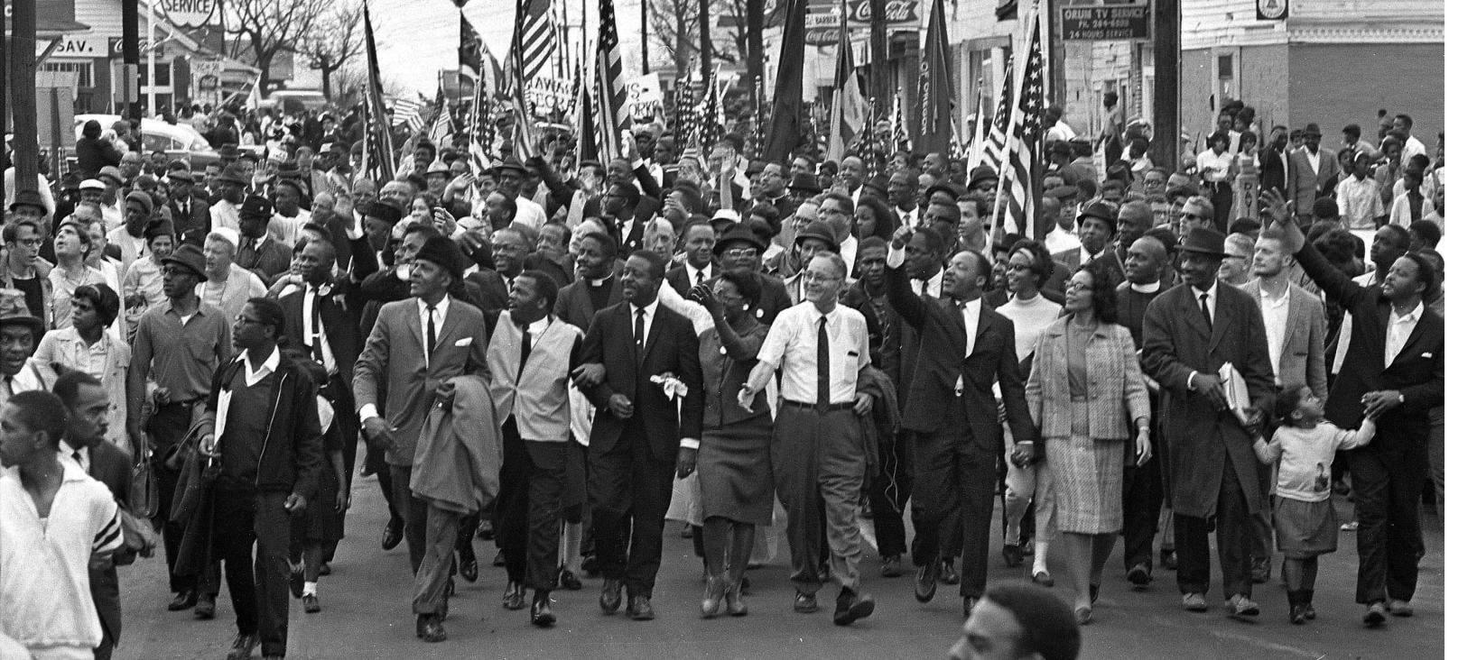 A group of protestors march for Civil Rights in the 1960s.