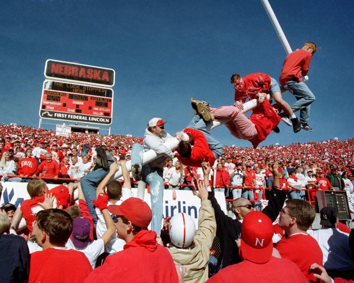 Nebraska fans topples a goal post on Oct. 29, 1994. Photo courtesy of Phil Johnson