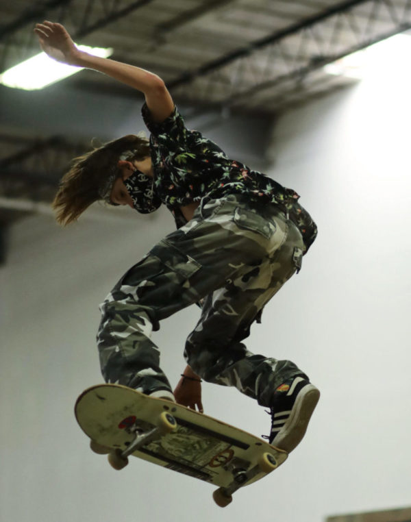 Airborne skater attempting a trick at The Bays indoor skatepark. Photo by Ben Skow Media