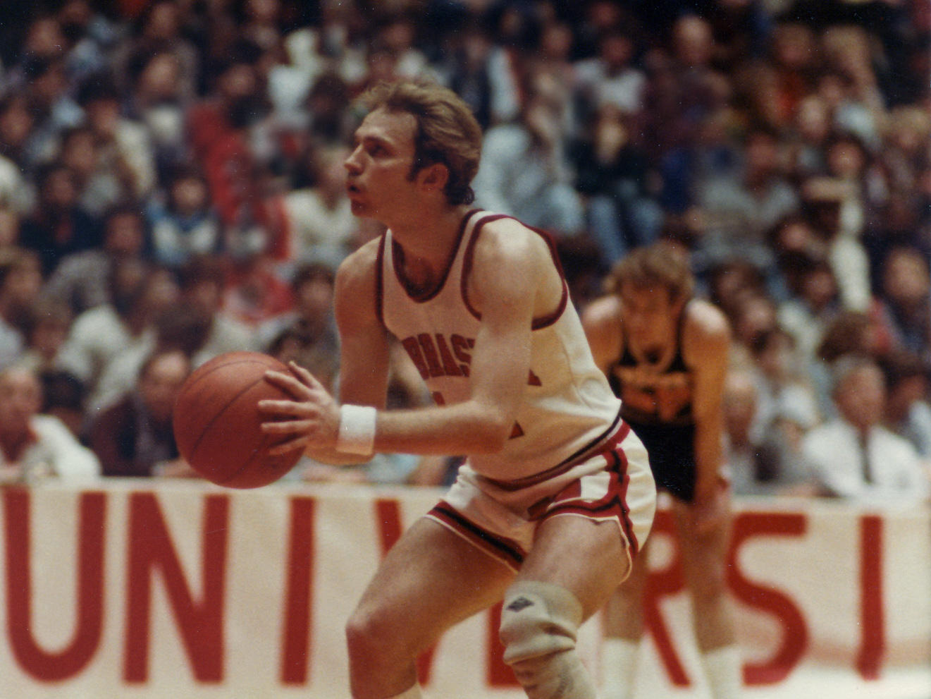 Jack Moore, the Huskers' consensus All-Big Eight point guard, Moore became the school's first three-time Academic All-Big Eight basketball player, won the 1982 Francis Pomeroy-Naismith Award as the nation's most outstanding senior collegiate basketball player under 6 feet. Photo by Huskers.com