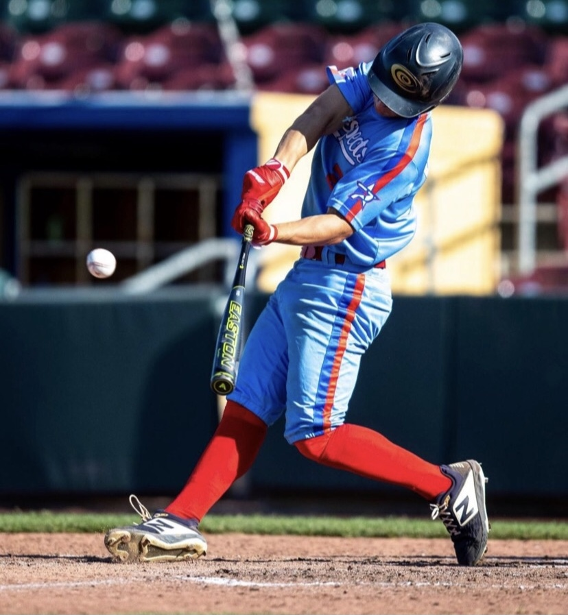 This is an image of Elkhorn South outfielder Luke Jessen, a Huskers baseball commit. In this photo, Jessen is in the middle of his batting swing.