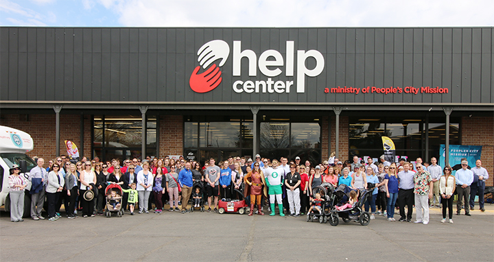 Large group of participants in front of the People's City Mission help center in 2019, for the One Day Without Shoes Drive.