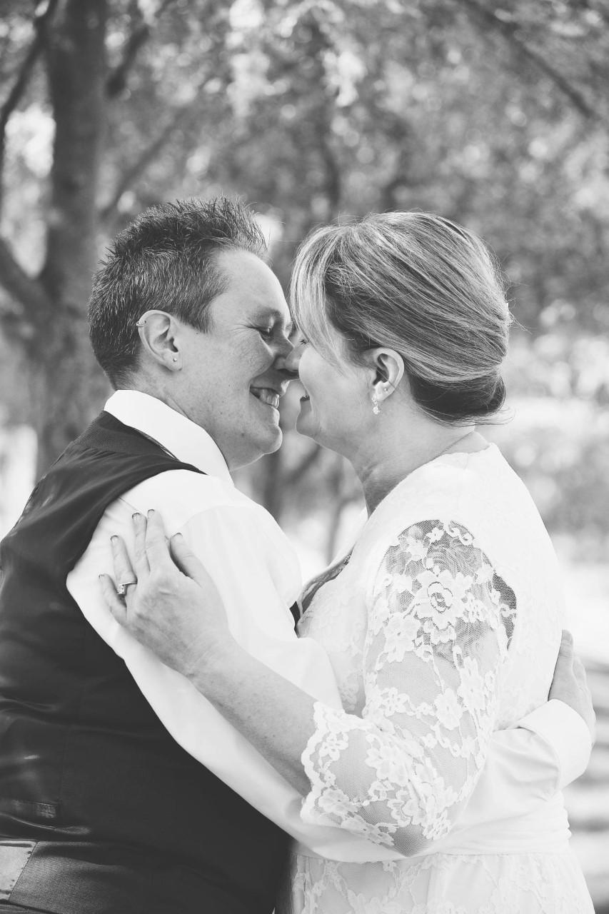 Close up of Joanna and Kristine on their wedding day in October 2020 in black and white. Photo courtesy of Jackie Akers.