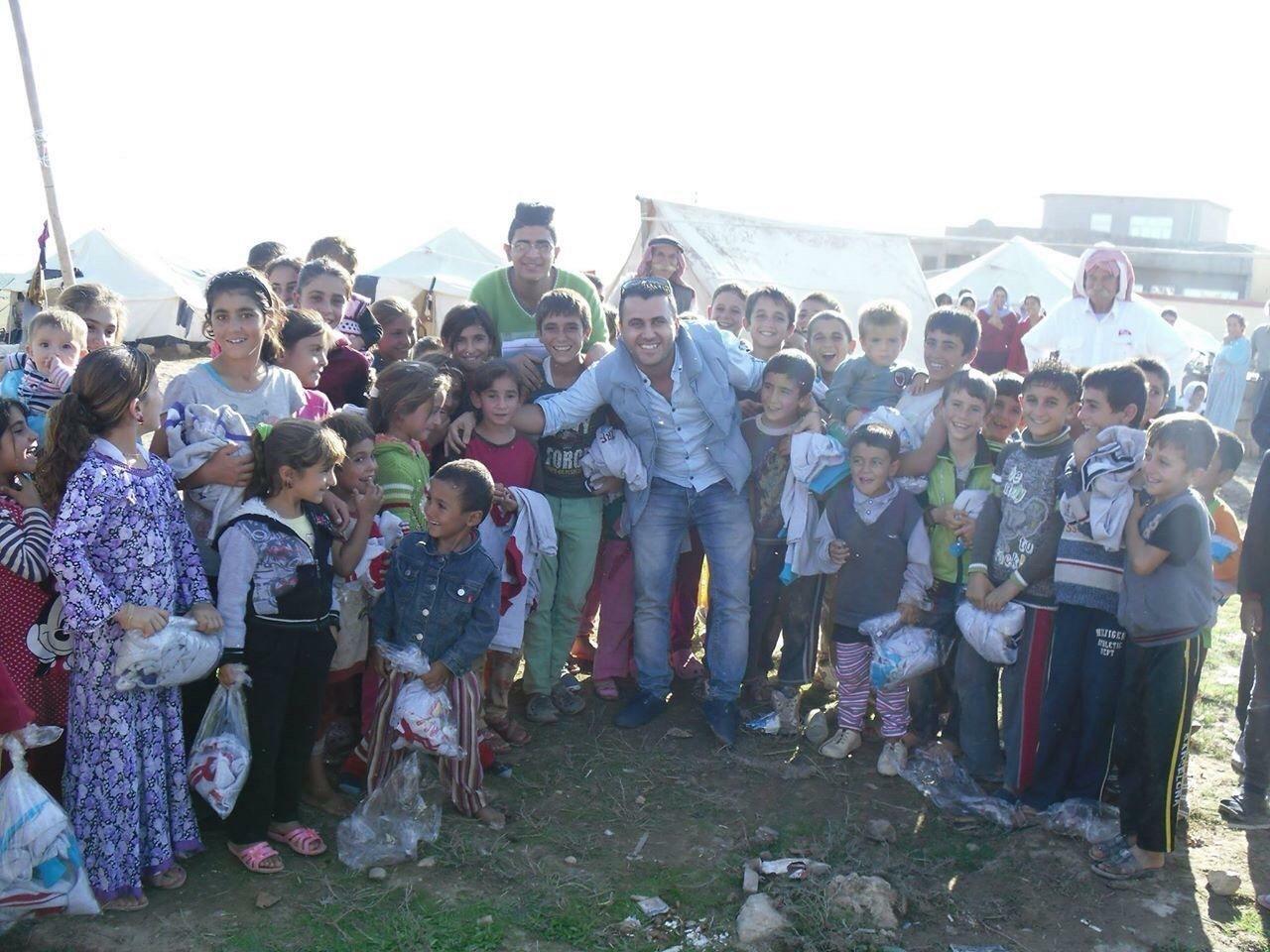 Huskers grad Falah Rashoka surrounded by refugee children at a Kurdistan campus in October 2014.