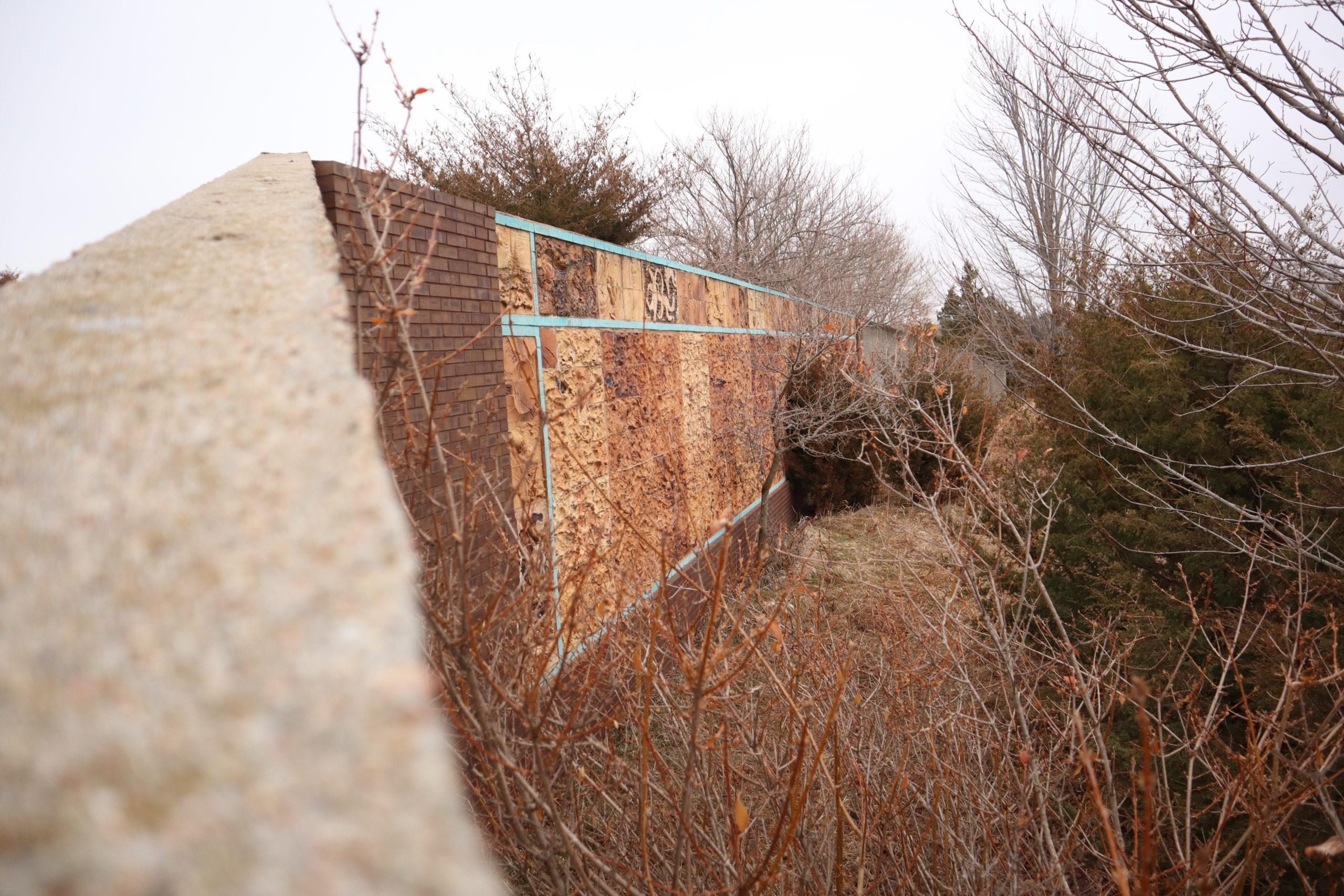 sculpturewall scaled - Prairie Peace Park now lies in pieces